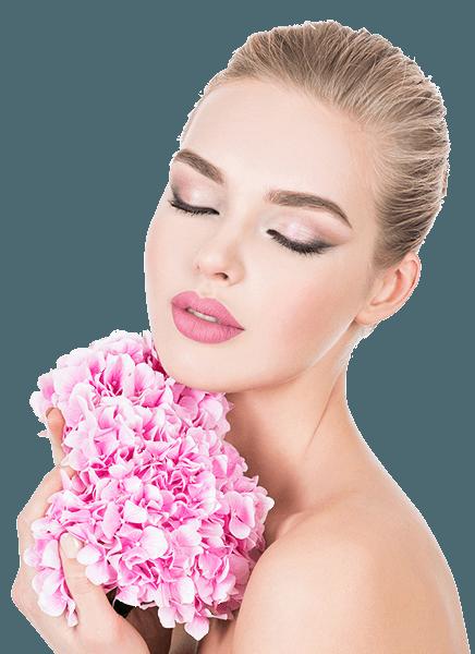 Vajina daraltma ameliyatı Elinde pembe çiçekler tutan kadın